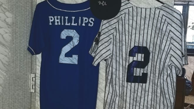The writer's No. 2 baseball jersey hangs next to a jersey decorated with No. 2 and Yankees pinstripes, just like Yankee Captain Derek Jeter would wear.