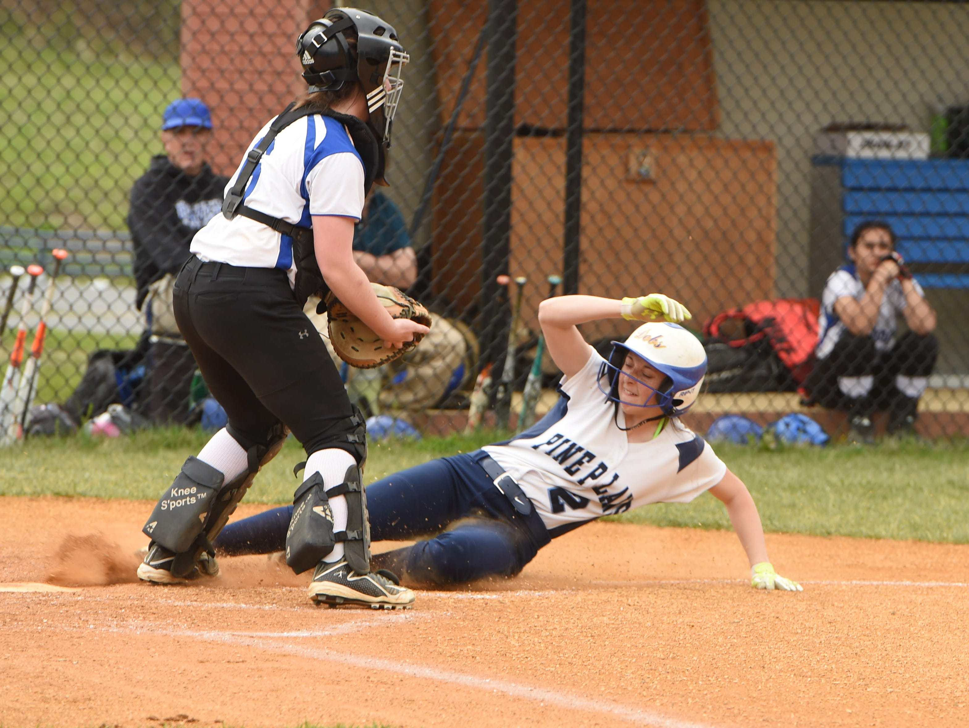 Pine Plains' Haley Strung slides safely into home while Millbrook's Abby Hackbarth waits for the throw during Monday's game.