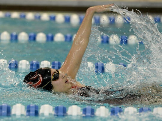Richmond's Marissa Peterson swims the 200 yard IM during a dual swimming and diving meet Wednesday, Jan. 6, 2015 in Centerville.
