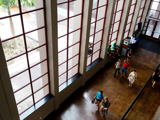 Ave Maria University students and family saunter through the student union on Thursday. Monday is the first day of classes for students.
