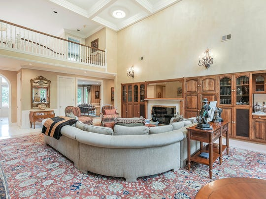 The two-story great room has  a coffered ceiling with