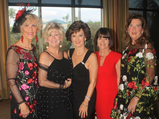 Susie Walsh, Sharon Cook, Candy Seward, Pam Brink and Kathryn Rogers enjoy dressing up.