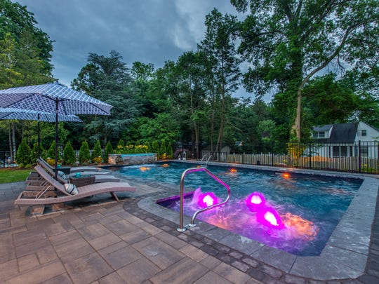 The Pool Boss, Rocstone Masonry, CLC Landscape Design and Pepe Plumbing & Heating Corp. worked together to create this Ho-Ho-Kus backyard.