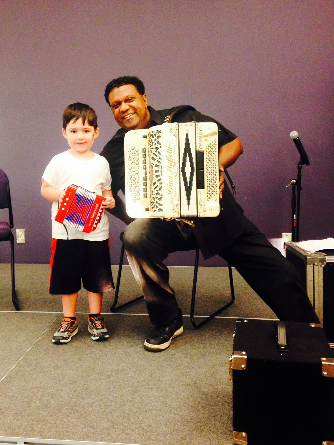 Dylan and Chubby Carrier pose with their accordions