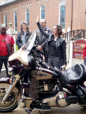 The Rev. Allison Beaulieu blesses bikes at a May 21 ceremony outside First Presbyterian Church of York.
