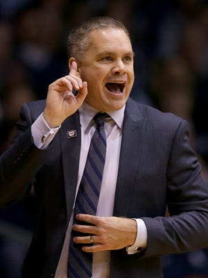 Butler Bulldogs head coach Chris Holtmann calls in a play to his players in the second half of their game Wednesday, December 21, 2016, evening at Hinkle Fieldhouse. The Butler Bulldogs defeated the Vermont Catamounts 81-69.