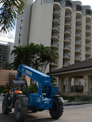 In this file photo from November 2016, heavy equipment carries construction material in front of the hotel. The Marco Island Hilton has been closed since June 1 as the hotel undergoes a $40 million renovation.