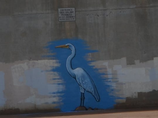 An unauthorized painting of a great egret appeared