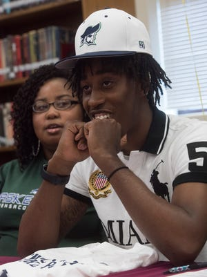 Pensacola High School basketball standout, Shawndarius Cowart, commits to Pensacola State College during a signing ceremony at PHS Tuesday, April 10, 2018.