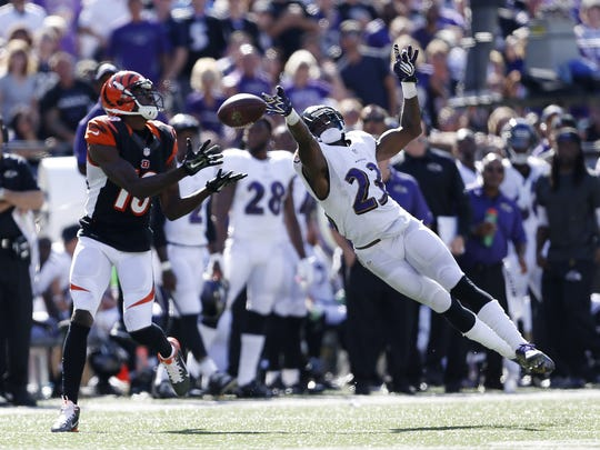 Cincinnati Bengals wide receiver A.J. Green (18) catches a touchdown pass against the Baltimore Ravens defensive back Chykie Brown (23).