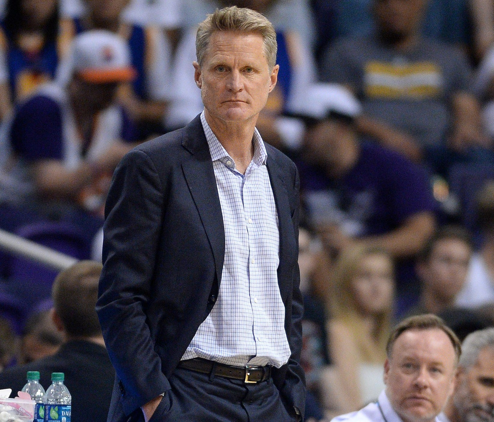 Golden State Warriors head coach Steve Kerr (left) looks on during the second half against the Phoenix Suns at Talking Stick Resort Arena.
