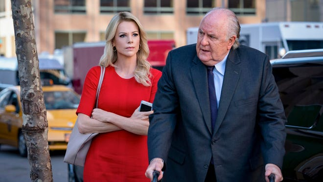 """Charlize Theron, left, as Megyn Kelly and John Lithgow as Roger Ailes in a scene from """"Bombshell."""""""