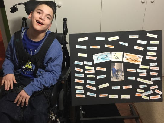 Dominic Stratton, a disabled Mount Laurel teen, sits