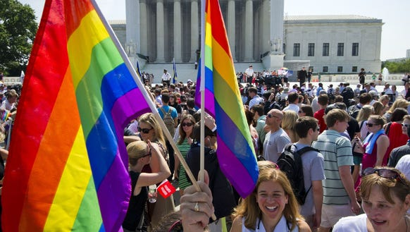 Gay-rights supporters gather Wednesday outside the