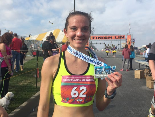 At 2:52:44, Kim Reed was the first woman across the