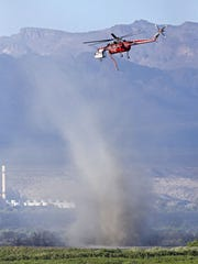 Helicopters battle the Willow Fire Sunday, Aug. 9, 2015, near Needles, Ariz.