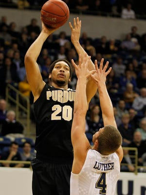 PITTSBURGH, PA - DECEMBER 01:  A.J. Hammons #20 of the Purdue Boilermakers pulls up for a shot against Ryan Luther #4 of the Pittsburgh Panthers during the game at Petersen Events Center on December 1, 2015 in Pittsburgh, Pennsylvania.  (Photo by Justin K. Aller/Getty Images)