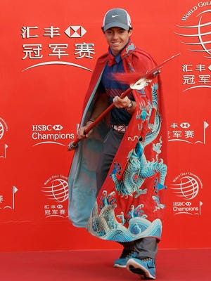 Rory McIlroy of Northern Ireland poses for photographers during a photo call at the HSBC Champions.