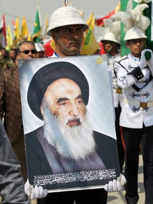 A placard of Grand Ayatollah Ali Sistani, who has said sodomites should be killed, at a Baghdad rally on  April 8, 2016.