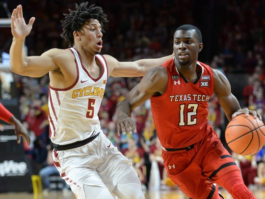 Texas Tech Red Raiders guard Keenan Evans (12) drives against Iowa State Cyclones guard Lindell Wigginton (5) during the first half at James H. Hilton Coliseum.