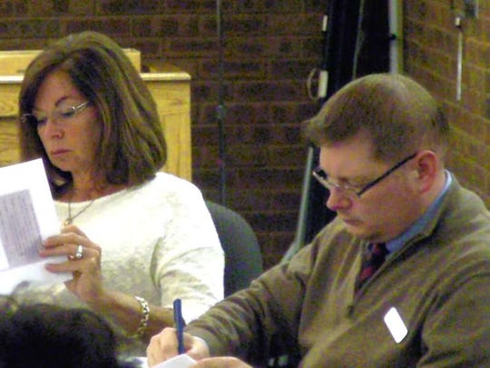 Councilwoman Patty Abrahamsen and Councilman Jeremy Jedynak look through their budget handouts.