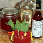 Homemade Summer Strawberry Basil Liqueur gives this Bourbon Berry Cooler its bright, fresh color.