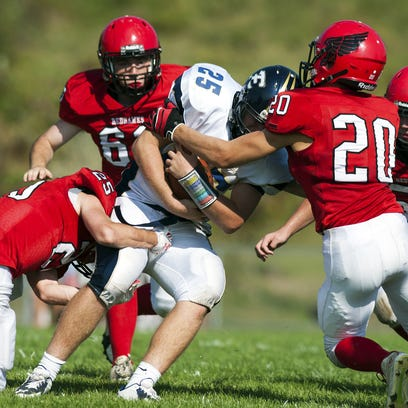 Essex's Liam Coulter (25) is tackled by CVU's Mason