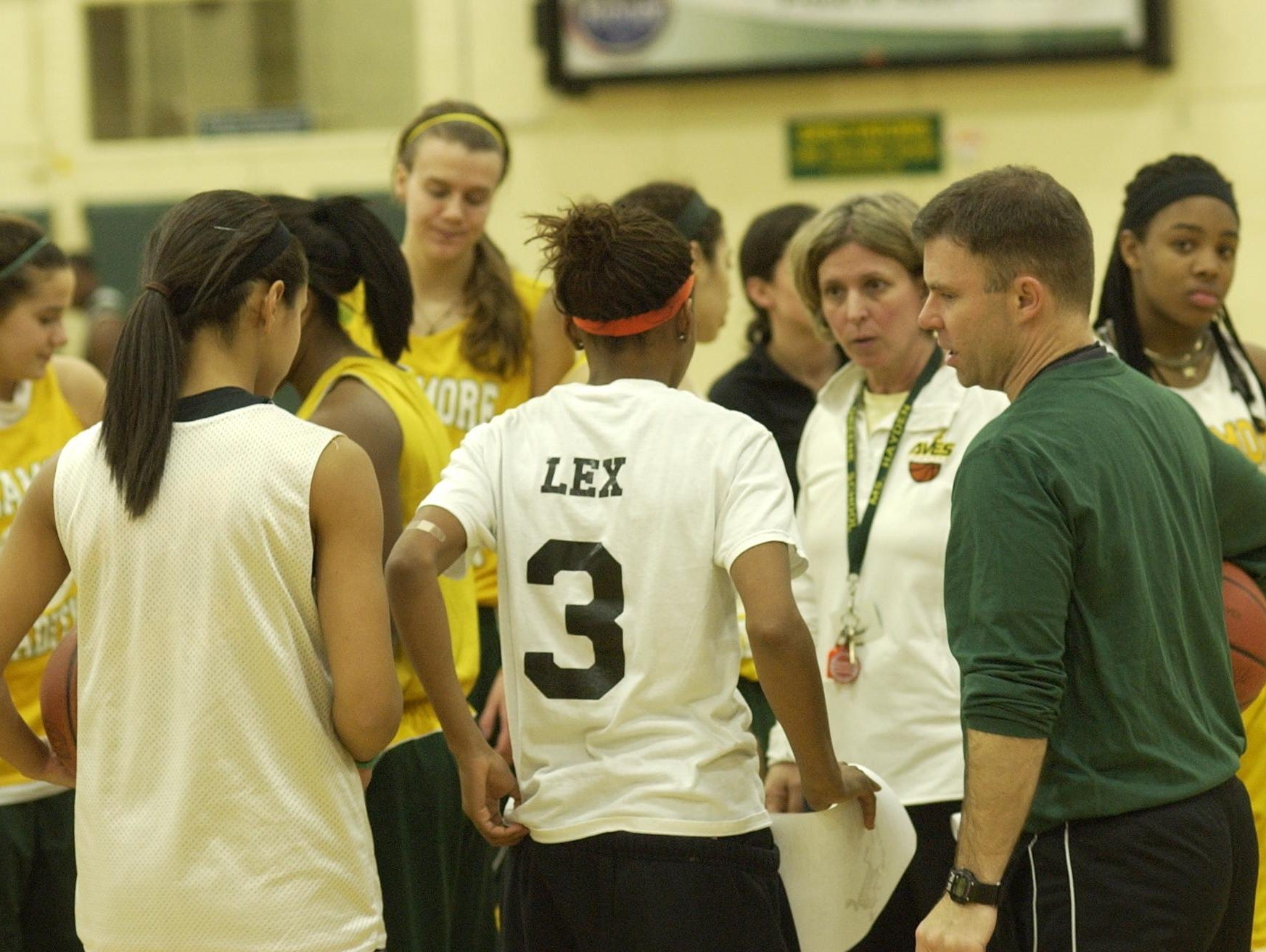 Lex Newbolt, No. 3, listens to then-Sycamore coach Paula Hayden (right of Newbolt wearing whistle). Hayden retired as varsity coach two seasons ago and recently retired from teaching at Edwin H. Greene Intermediate School.