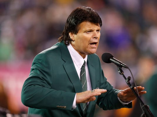 """FILE - In this Oct. 8, 2012, file photo, former New York Jets defensive end Mark Gastineau speaks during halftime of an NFL football game between the Jets and the Houston Texans in East Rutherford, N.J.  Gastineau made an emotional plea to NFL Commissioner Roger Goodell to help former players like him who are dealing with football-related health issues. Gastineau says during a radio interview Thursday night, March 8, 2018, that he wants ailing players to be """"treated right"""" by the NFL. The 61-year-old Gastineau announced last year that he was diagnosed with dementia, Alzheimer's disease and Parkinson's disease. (AP Photo/Julio Cortez, File)"""