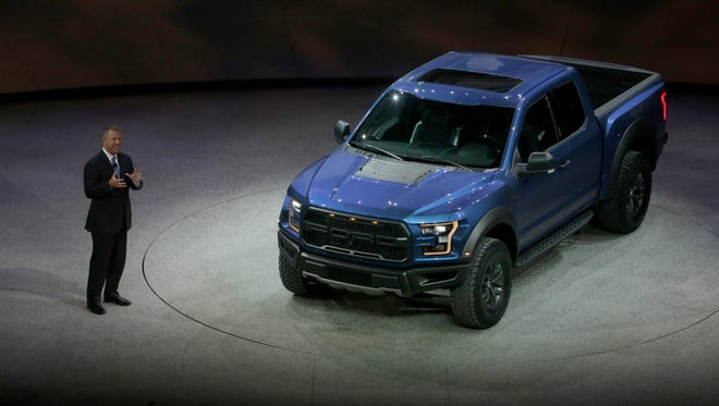 Ford's Joe Hinrichs,  Executive Vice President and President, the Americas introduces the 2017 F-150 Raptor high-performance, off-road pickup at the 2015 Ford F-150 truck on Monday, Jan. 12, 2015 at Cobo Center in Detroit. Diane Weiss/Detroit Free Press