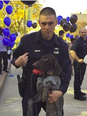 Wayne State University police officer Collin Rose honors the memory of fallen DPD Officer Patrick Hill by naming his new K9 partner Wolverine, which was Hill's code name. Rose was shot near Wayne State Tuesday night.