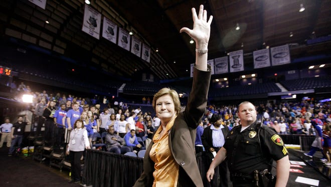 FILE- In this March 19, 2012, file photo, Tennessee head coach Pat Summitt waves as she leaves the court after Tennessee defeated DePaul 63-48 in an NCAA tournament second-round women's college basketball game in Rosemont, Ill. Summitt, the winningest coach in Division I college basketball history who uplifted the women's game from obscurity to national prominence during her career at Tennessee, died Tuesday morning, June 28, 2016. She was 64. (AP Photo/Nam Y. Huh, File)