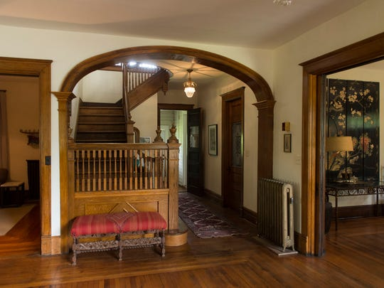 The staircase and foyer look much the same today as when the house was built. The dining room is to the right. The family room is to the left.