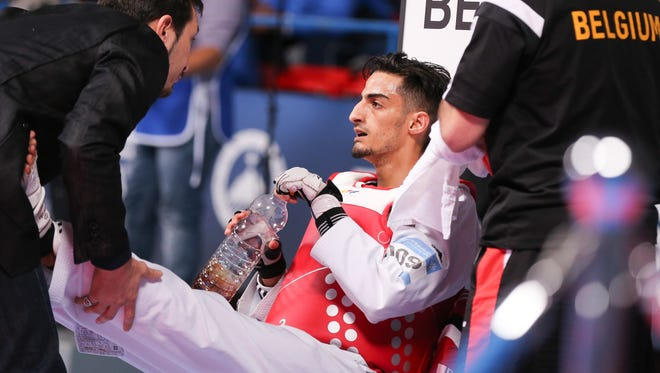 Belgium's Mourad Laachraoui  takes a break  during his fight against Spain's Jesus Tortosa Cabrera,  at  the European Taekwondo Championships in Montreux, Switzerland on May 19. 2016.