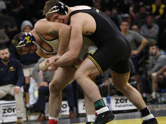 Iowa's Cash Wilcke wrestles Michigan's Kevin Beazley