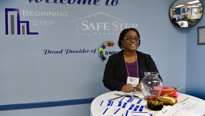 Denee Walker, a client case coordinator, welcomes folks to the open house.