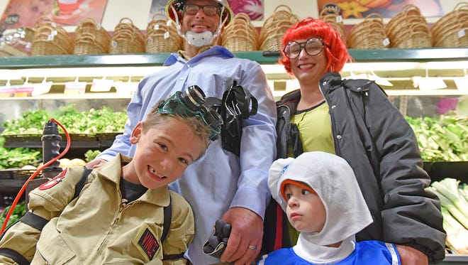 The Ghostbuster family: Parents Erik Martinelli and Michelle Martinelli with 7-year-old Vince Martinelli and 2-year-old Jude MartinElli.
