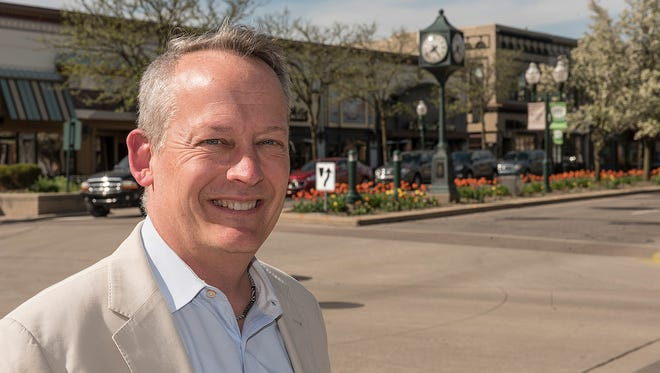 Mayor Dan Dwyer stands in the downtown of a city he has served as mayor.