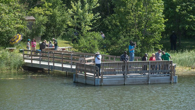 The fishing pier at Founders Park was busy on Monday morning.