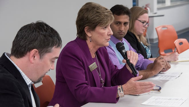 Novi City Council incumbent Gwen Markham answers a question submitted by an audience member. Others at the table during the candidate forum in Novi are council incumbent Andrew Mutch, mayoral candidate Binyamin Qamruzzaman and council candidate Kelly Breen.