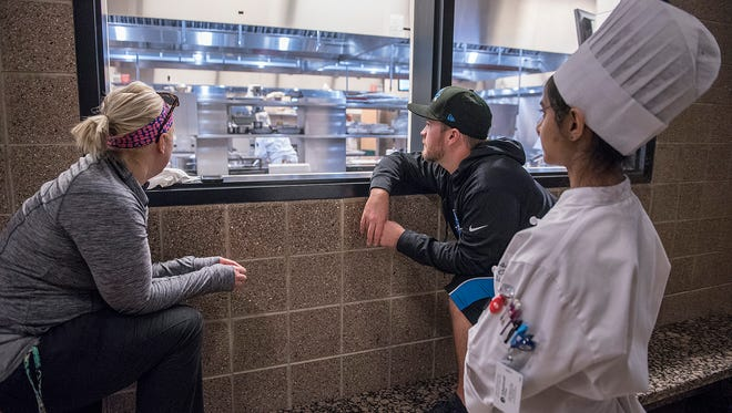 Watching the testing from the hall outside the kitchen in this 2017 file photo, Nicky Pullen is and alumna of Schoolcraft's culinary program, Kevin LaFave, a native of Westland now living in North Carolina, is a Schoolcraft culinary grad. He traveled back to Michigan to support Chef Shawn Loving. Taarika Singhal, of Canton, also watches.