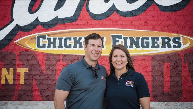 Justin and Jennifer Jones will open Raising Cane's chicken restaurant in West Des Moines this May.