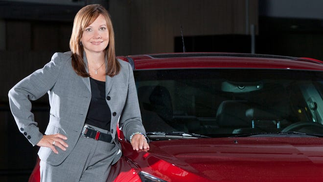 Mary Barra with a Chevrolet Cruze in s 2011 photo
