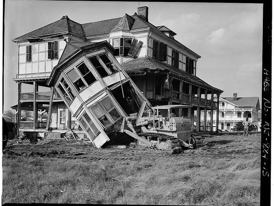 The Long Branch beachfront cottage where Ulysses Grant lived being bulldozed in 1963.