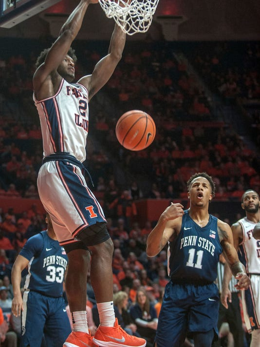 Illinois forward Kipper Nichols (2) dunks over Penn State forward Lamar Stevens (11) during the first half of an NCAA college basketball game in Champaign, Ill., on Sunday, Feb.11, 2018. (AP Photo/Rick Danzl)