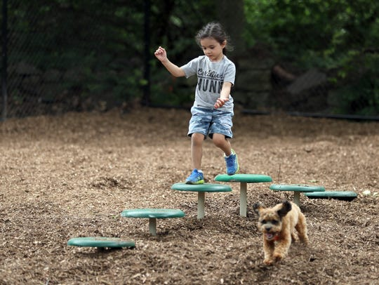 Tyler Cardus, 3, of Suffern takes over a part of the
