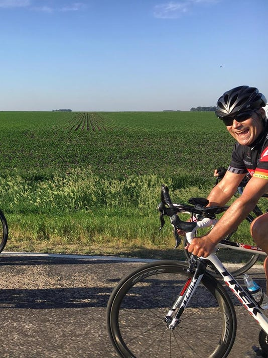 Dr. Richard Deming on his bicycle.jpg