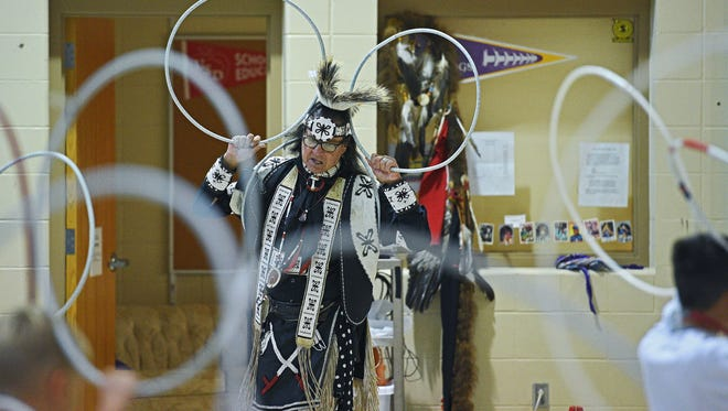 Dallas Chief Eagle, an artist in residence at R.F. Pettigrew Elementary School, gives a hoop dancing demonstration with the help of students Thursday, Oct. 20, 2016, at R.F. Pettigrew Elementary School in Sioux Falls.