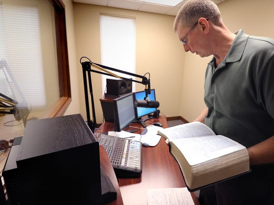 The Rev. Douglas Schroeder checks his notes and scripture readings before recording a segment in The Word Today recording studio at Our Shepherd Lutheran Church in Greendale.