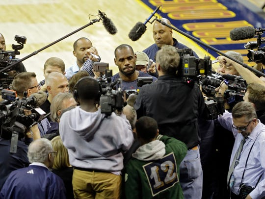 Cleveland Cavaliers' LeBron James besieged by the media